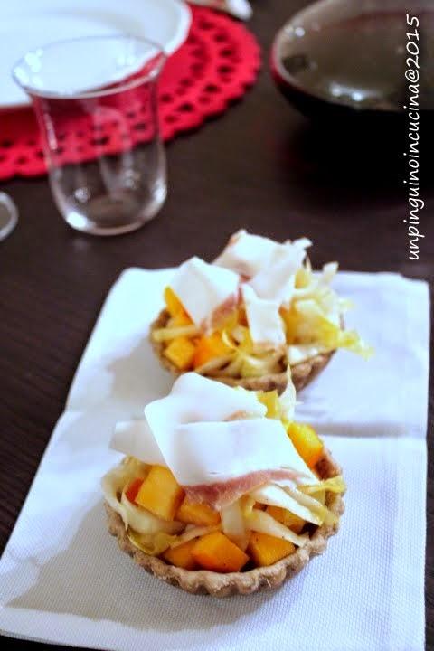 Tartellette di lenticchie con indivia, caco vaniglia e lardo di Colonnata